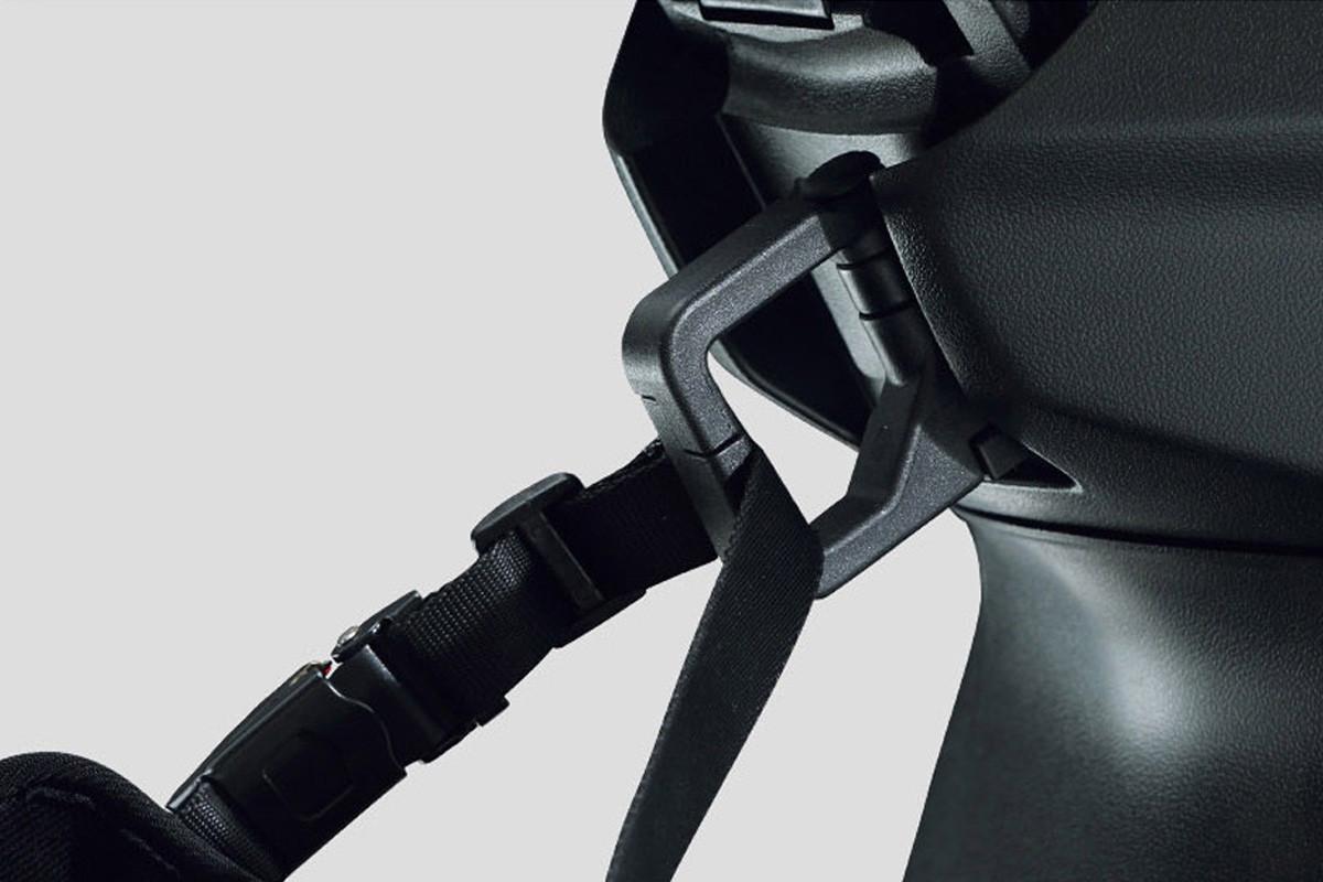 A imagem mostra o gancho de transporte da VR 150 em fundo branco.