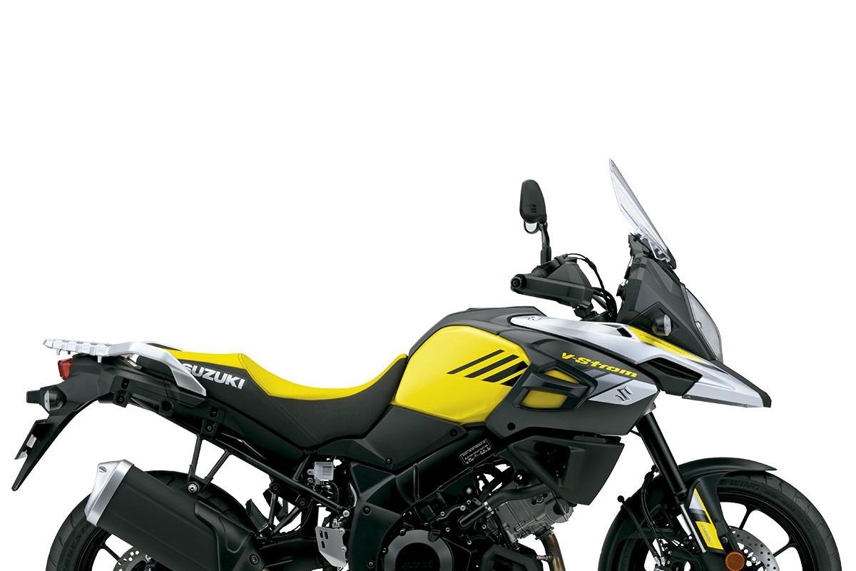 A imagem mostra a lateral V-Strom 1000XT Action amarela em fundo branco.