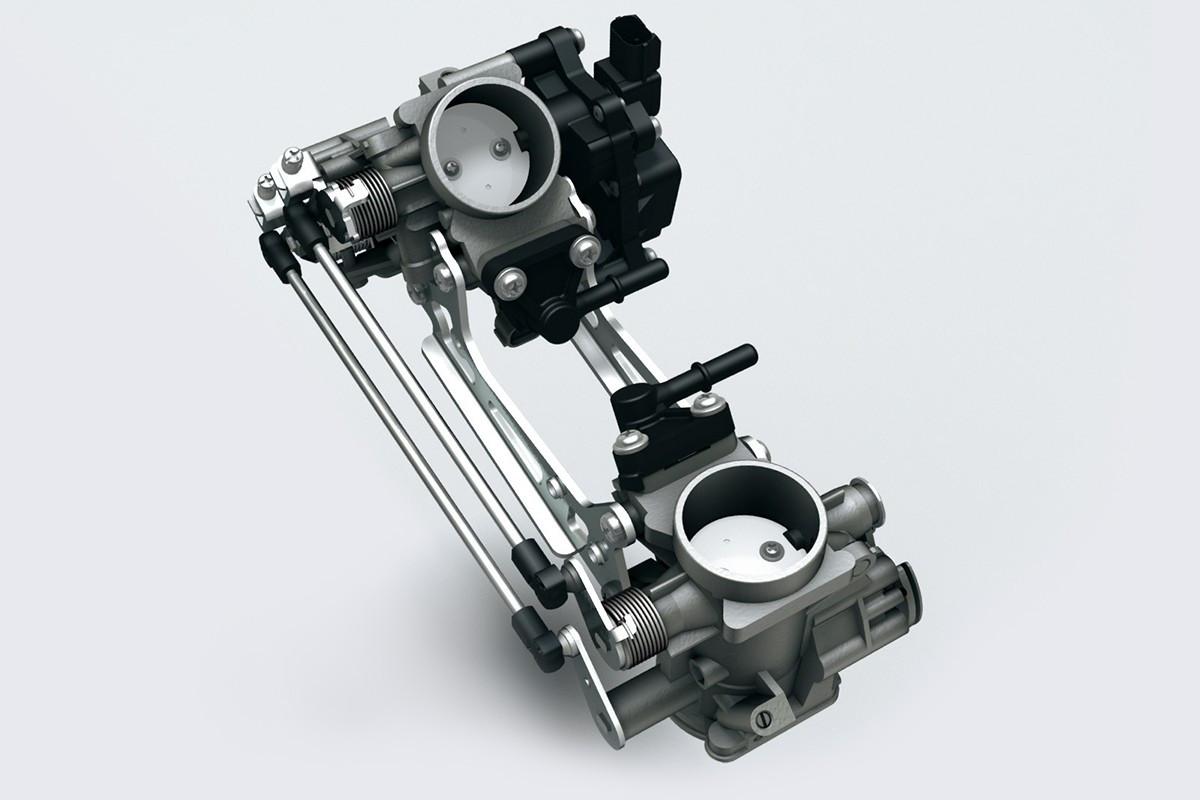 Imagem que mostra como funciona o sistema de injeção de combustível da V Strom 650 XT de corpo duplo em fundo branco